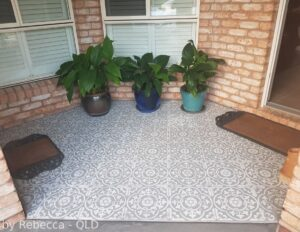 Painted patio floor using a tile stencil.