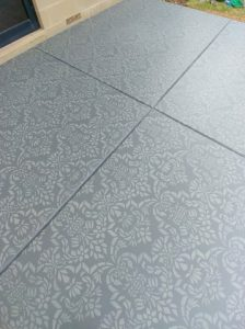 Stencilled floor with a large damask stencil